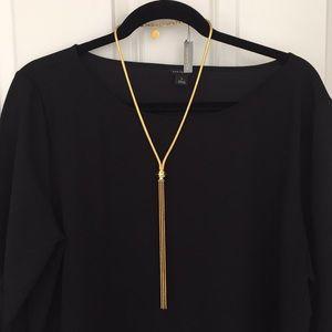 NWT. Louise et Cie gold tone tassel necklace.